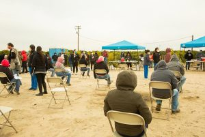 People wait in observation after receiving vaccinations at the event