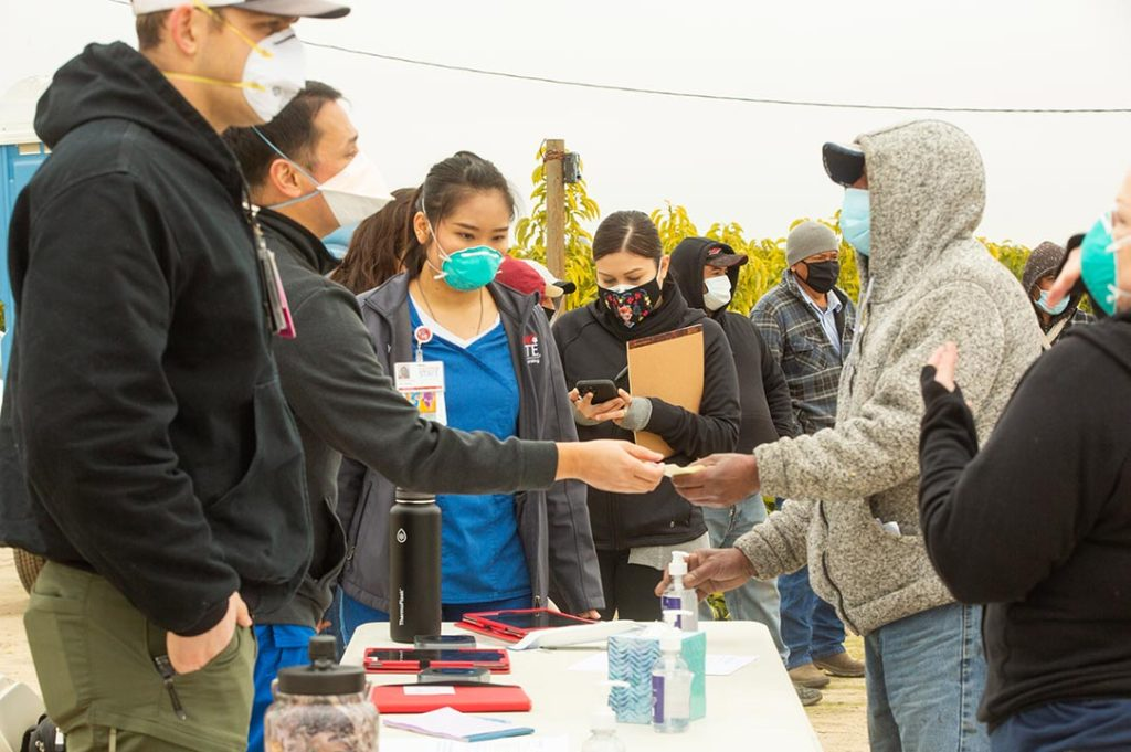 CFF staff speak with people at a vaccination event
