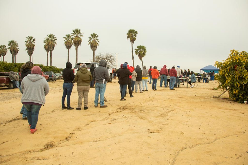 People wait in line at the vaccination event